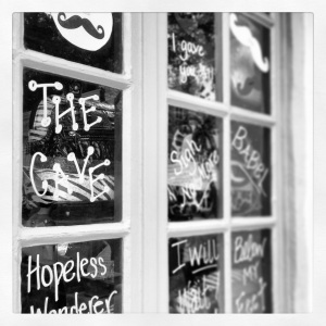 A window of Mumford song lyrics and obligatory mustache in downtown St Augustine