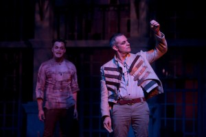 Photo by USC.  Richard Willis (right) as Claudius with Laertes.