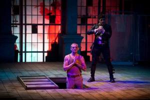 "Photo by USC.  Hamlet comes up behind Claudius as he's ""confessing."""