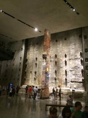The Last Column, with the sea wall in the background. 9/11 Memorial & Museum