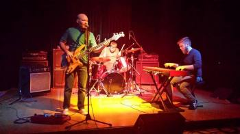 The Fire Tonight playing a show in 2014. Left to right: Collin Derrick, Stephen Russ, Jesse James